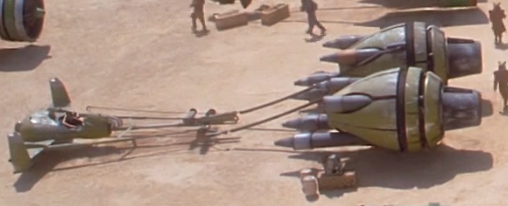 File:Boles Roor in his podracer.png