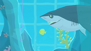 """S1 E16 Kelly places the net within the fish tank. Sonny says """"Holy carp! It's a raid!"""""""