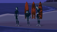 S2 E8 They land on the beach with their boards behind them