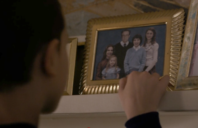 File:Eleven looks at the Wheeler family photo.png