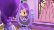 Plum is looking at herself in the mirror