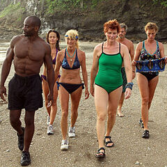 Tyrone, Yve, Jane, Jill, Marty and Holly walking on the beach.