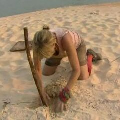 Sandy looks for the Hidden Immunity Idol.