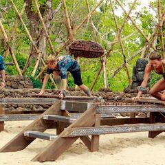 Christine and Mikayla build their bridge.