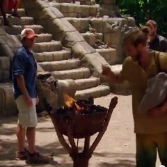 Matthew throws his buff in the fire.