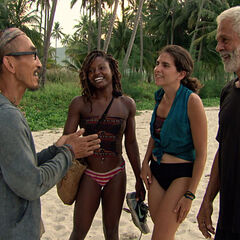 Tai greets the reward winners after they return to camp.