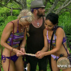Russel and his alliance reading a clue to a Hidden Immunity Idol.