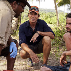 Neal is pulled away from the tribe for an examination.