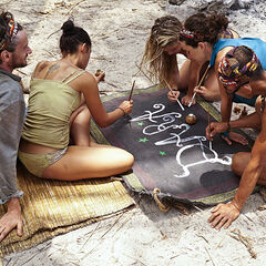 Members of Dara painting the tribe flag.