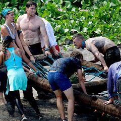 Luke helps bring Asaga's raft ashore in the <i>Race to Shore</i> reward challenge.