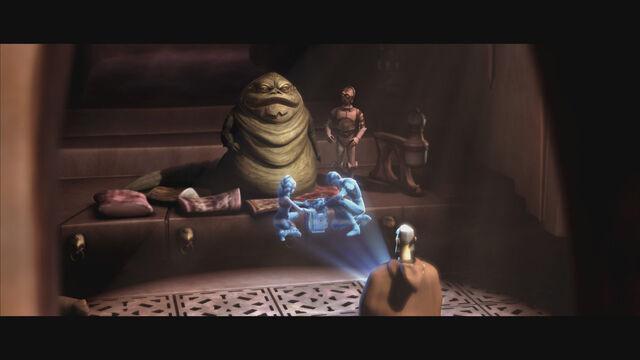 File:Jabba watches a misleading hologram at his palace.jpg