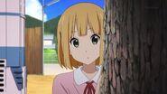 Midori behind tree