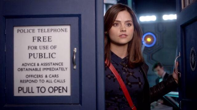 File:Clara looks out of TARDIS.jpg