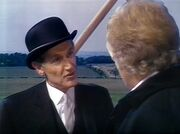 Time Lord Messenger Warns Doctor of Master's Presence