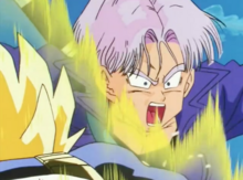 Vegeta punches Future Trunks in the stomach