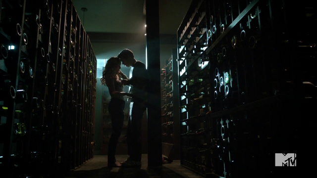 File:Teen Wolf Season 3 Episode 2 Dylan O'Brien Caitlin Custer Stiles and Heather in the wine cellar.png