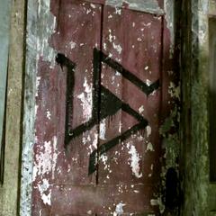 Alpha Pack symbol on the door