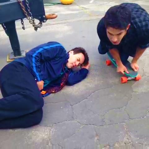 File:Teen Wolf Season 3 Behind the Scenes Orny Adams Tyler Posey skate board.png