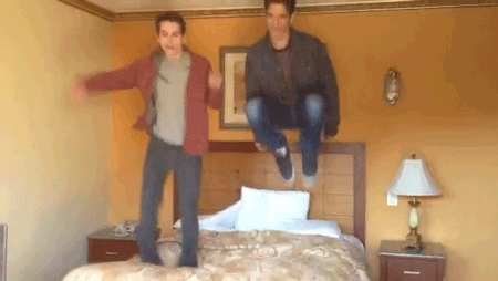 File:Teen Wolf Season 3 Behind the Scenes Tyler Posey Dylan O'Brien Motel Glen Capri Bed Jumping 2.png