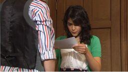Mara reading a letter