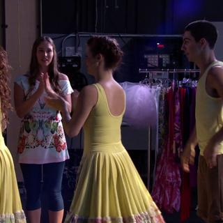 Phoebe applauds the dancers.