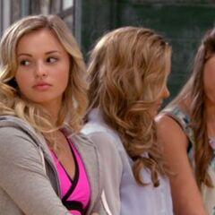 Phoebe regards something that Kate is showing her.
