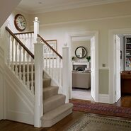 White-and-Wood-Floor-Hallway-25-Beautiful-Homes-Housetohome