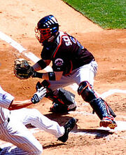 200px-Brian Schneider blocking the plate in May 2008