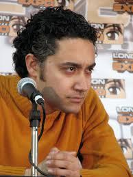 File:Alessandro Juliani Orange Sweater 2.jpg