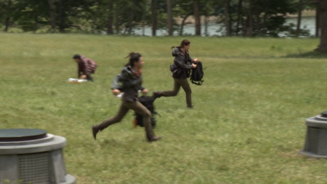 File:District 4 Female fleeing.png