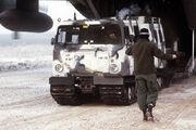 800px-M973 SUSV offloading C-130 Hercules