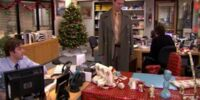 Seemingly wrapped Dwight's chair, desk and everything on it in wrapping paper