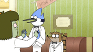 S6E05.093 Muscle Man Giving Mordecai Ten