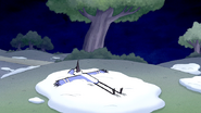 S6E11.003 Mordecai Laying on Snow