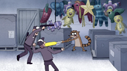 S4E36.210 Rigby Whacking a Security Guard 01