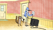 S4E20.063 Rigby Timing Mordecai on the Phone