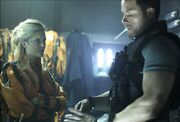 Guy-Pearce-Maggie-Grace-Photo-3-Lockout