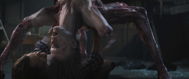 File:Edvard-Thing begins to assimilate Adam - The Thing (2011).png