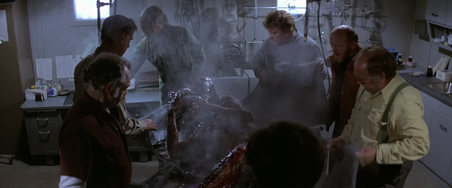 File:The men examine Split-Face - The Thing (1982).png