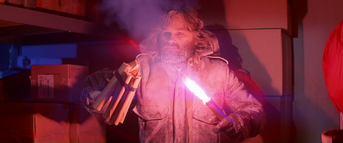 MacReady threatens the men with dynamite - The Thing (1982)