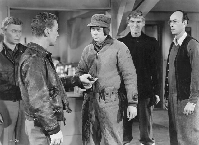 File:Bob brings news of the Thing's escape - The Thing (1951).jpg