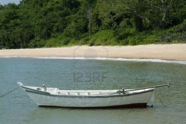 File:496940-small-white-wooden-fishing-boat-near-the-beach-in-chonburi-province-thailand.jpg