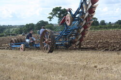 Cable pulled plough closeup
