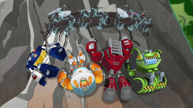File:SearchoftheGriffinNest Rescue Bots stuck to rock.jpg