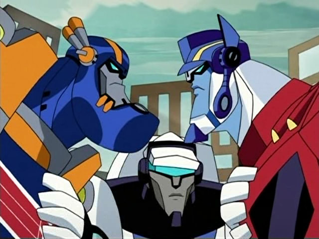 File:Sentinel vs Optimus, with Jazz in the middle.jpg