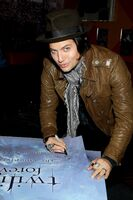Jackson Rathbone with poster