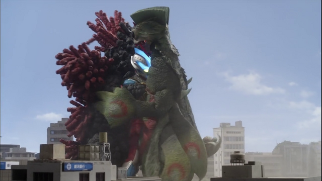 File:Ginga is caught in a combat hug between Velokron and Doragory.png