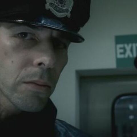 Pierce poses as a police officer.