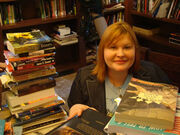 Cassandra Clare with books