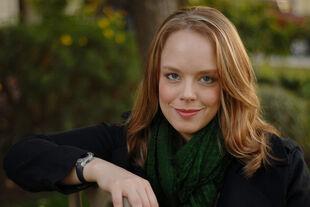 Melissa F. Olson